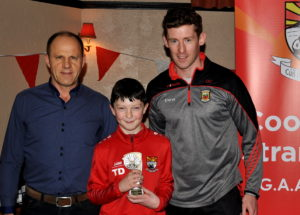 coolera-strandhill-most-improved-u12-hurler-tadhg-doggett-receiving-his-award-from-anthony-ryan-and-david-clarke