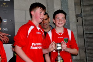 ransboro-ns-joint-capts-jamie-walsh-and-mark-mcdaniel-receive-the-winners-cup-after-the-cumann-na-mbunscol-final