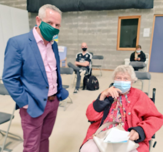 Head of the HSE, Paul Reid with 87 year old Mary O'Connor. The oldest person to receive a vaccine at a walk in centre. Credit @paulreiddublin on Twitter